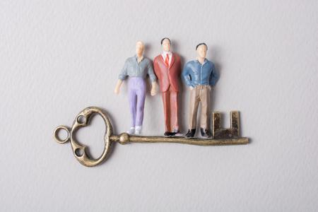 Tiny figurine of man miniature and retro key