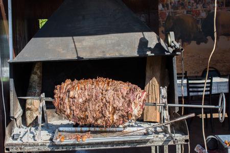 Turkish cag Kebab on pole in horizontal position