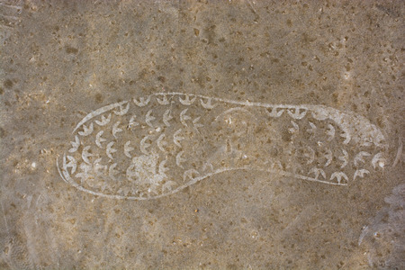 Footstep pattern seen on a concrete background