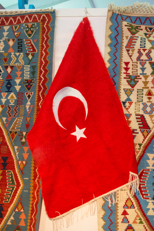 Turkish national flag hang in view in open air Imagens