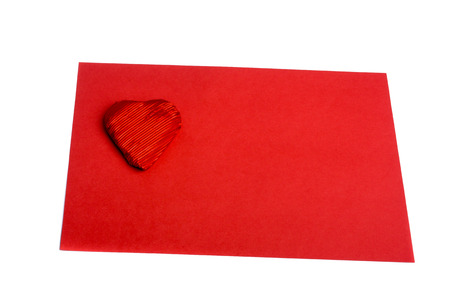 Red heart shape on red sheet of paper on white background Stock Photo