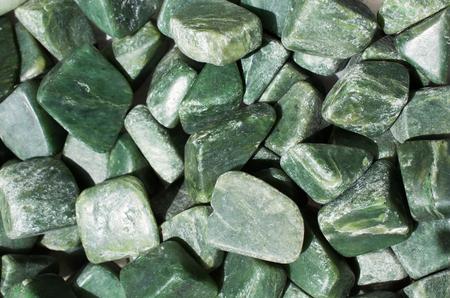 jade gem stone as natural mineral rock specimen