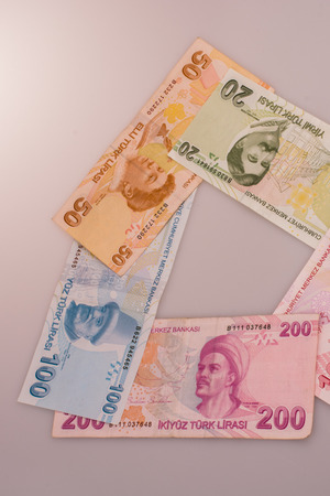 Turksh Lira banknotes of various color, pattern and value on white background Stock Photo