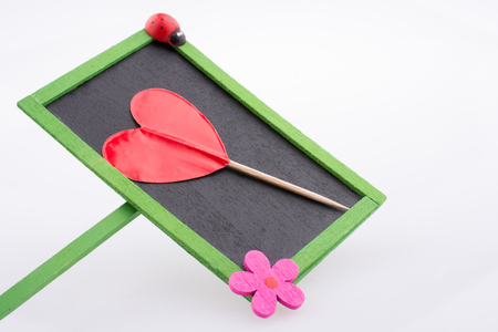 Little red color heart shape and wooden    notice board