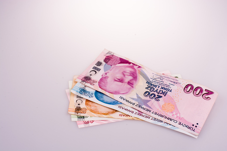 Turksh Lira banknotes of various color, pattern and value on white background