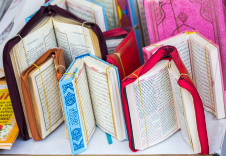 Islamic Holy Book Quran on the market shelf Stock Photo