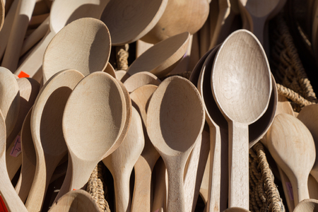 dozens of soup spoon or tablespoon made of wood Stock Photo