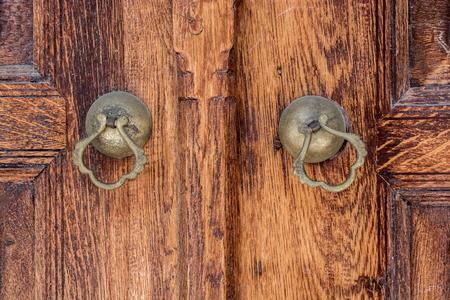 Old Handmade ottoman door knob on wood