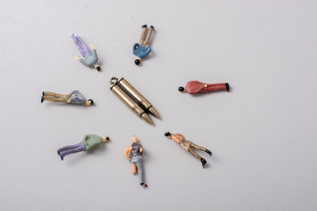 Men figurine around Bullet as Conceptual against the war photography