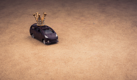 Golden color crown model and a model car