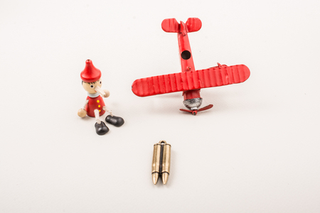 Airplane, Bullet and wooden pinocchio with his long nose Stockfoto