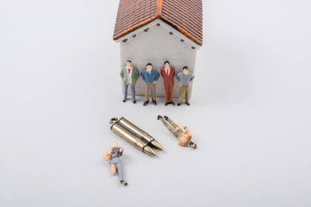 Men figurine model and Bullet as Conceptual against  war photography