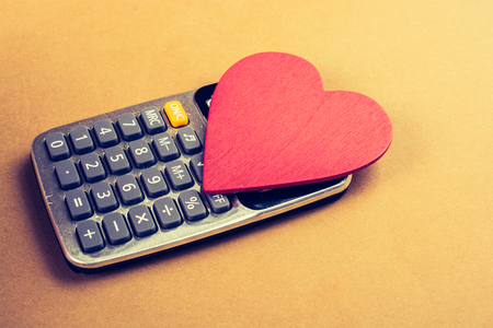 Heart shape and calculator  with a keyboard and display Stock fotó