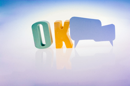 Speech bubble the word OK written with colorful letter blocks 스톡 콘텐츠