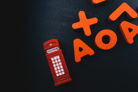 Telephone booth and colorful letters of Alphabet made of wood