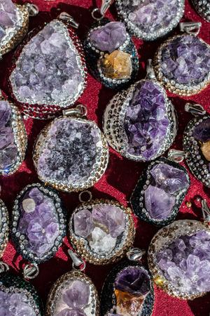 Raw violet amethyst rock  as a necklace Archivio Fotografico