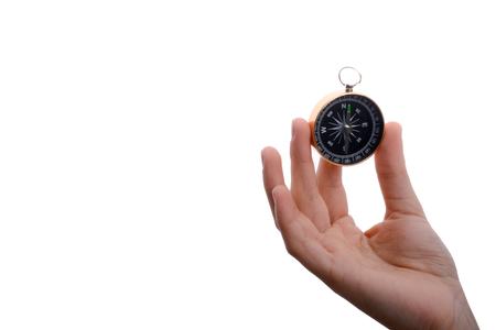 Isolated compass in child's hand  on a white background
