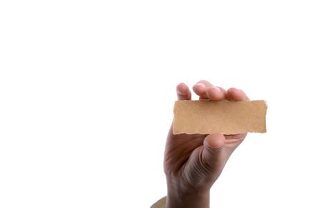 hand holding a piece of blank torn notepaper Reklamní fotografie