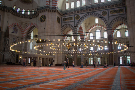 Bright Lamps on circular chandelier in a big mosque Editorial