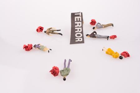 Human Figures near torn Newspaper Title 写真素材
