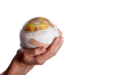 Child holding a globe with plaster in his hand on a white background Banque d'images - 116032689