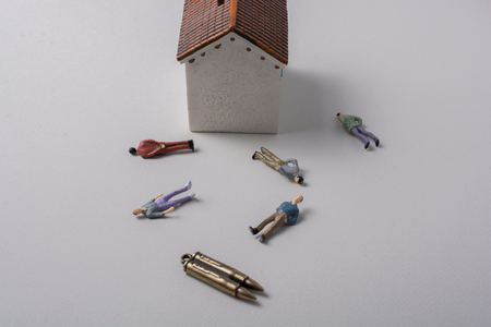 Man figurine model and Bullet as Conceptual against  war photography