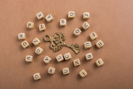 Letter cubes of made of wood around retro key Reklamní fotografie