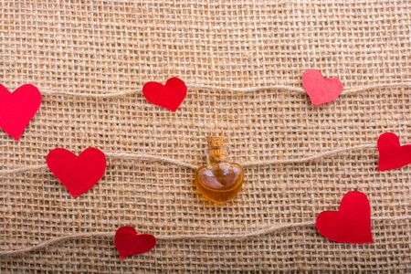 Love concept with heart shaped papers on linen threads Stock Photo