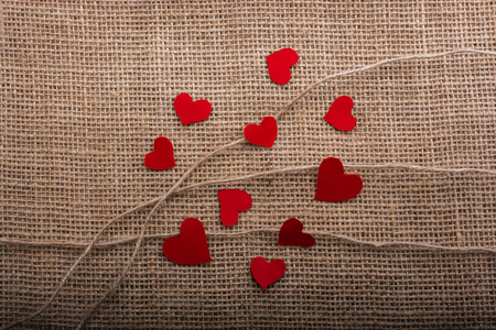 Love concept with heart shaped papers on linen threads Imagens