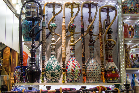 Group of eastern hookahs placed of various colors on a shelf
