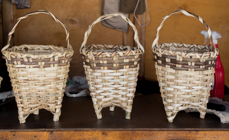 Empty wicker baskets are for sale in a market
