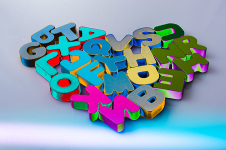 Colorful letter blocks shape heart on white background