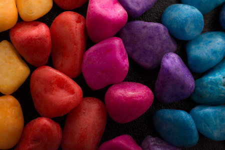 Pile of little colorful pebbles as stone background