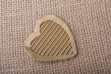 Heart shaped cut out of a brown cardboard Stock Photo