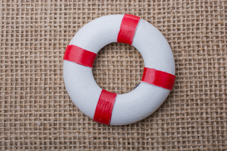 Lifesaver or life preserver on a fabric background
