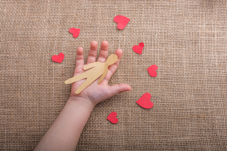 Love concept for with paper hearts and paper man