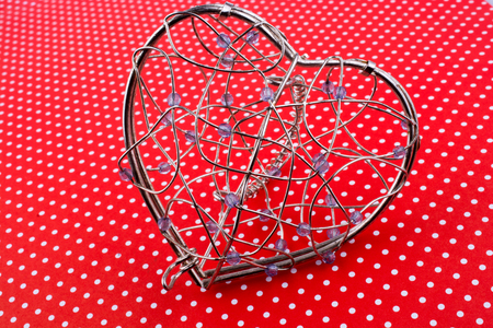 Heart cage on a red background