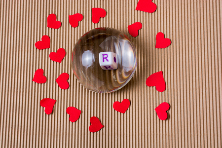 Red paper heart, letter R and half  glass globe Banque d'images - 120192688