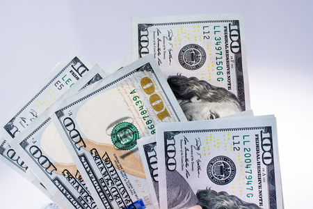 American 100 dollar  banknotes made of paper placed on white background