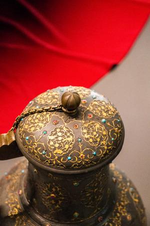 Very old style metal ewer water jar in view