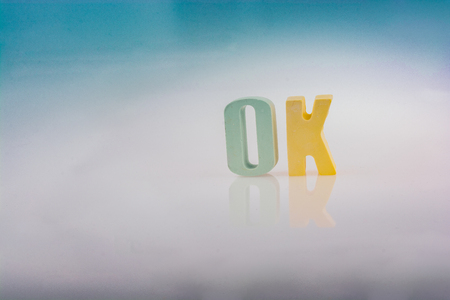 the word OK written with colorful letter blocks