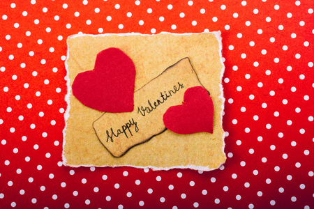 Love icon and Valentines day wording on torn paper Imagens