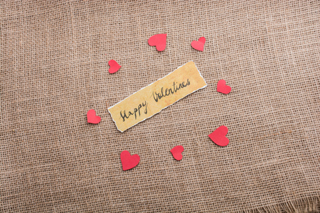 Love icon and Valentine's day wording on torn paper