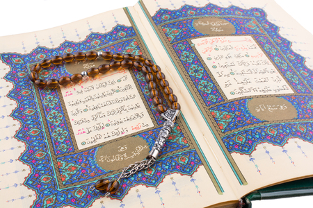 Hand holding The Holy Quran on a white background Stock Photo