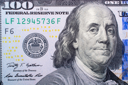 Close up of Benjamin Franklin face on 100 US dollar bill 写真素材