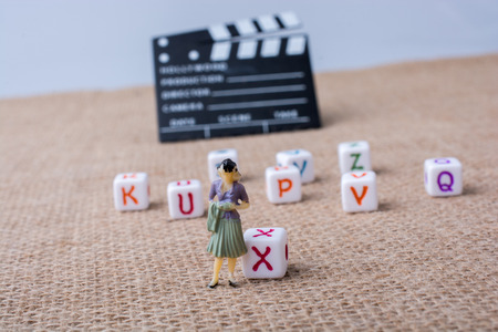 Colorful letter cubes beside a director clapper board