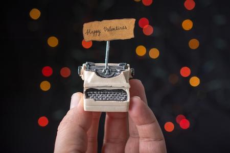 Valentine's day wording on torn  typewriter as Love concept 免版税图像