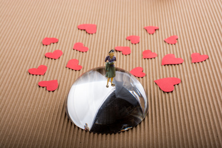Woman figurine and Love concept with red paper hearts Stock Photo