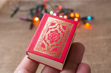 Islamic Holy Book Quran with lights behind