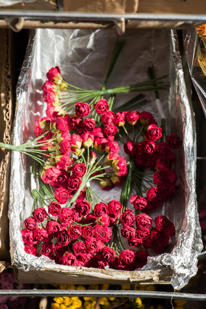 Plastic unreal fake flowers colourful flowers